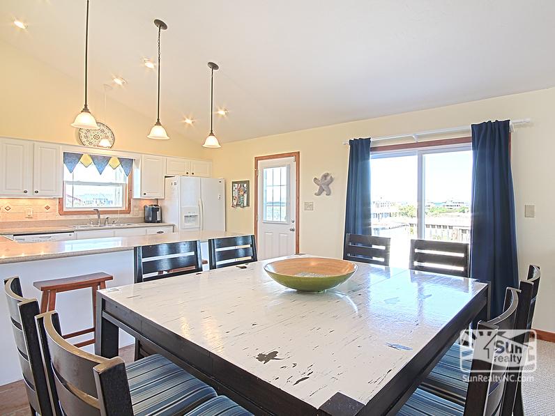 View into Kitchen with Horizon Ocean Views
